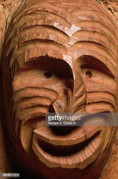 Carved into the trunk of a living tree the face of the Great Hunchbacked One grimaces in pain after suffering a broken nose in a struggle London...