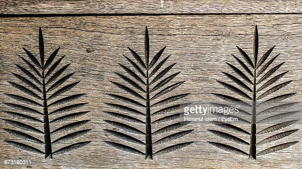 Carved Leaves On Wooden Plank