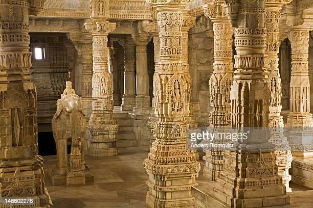 carved marble pillars and elephant in the chaumkha jain temple. - ranakpur temple stock photos and pictures