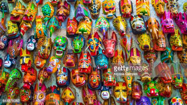 carved mayan masks for sale in antigua, guatemala - cultura maya fotografías e imágenes de stock