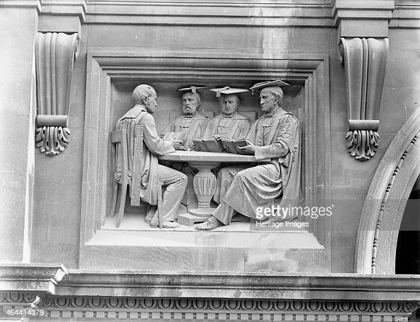 Carved panel in examinations schools gateway Oxford University Oxford Oxfordshire c1860c1922 The carved panel in the porch shows three fellows...