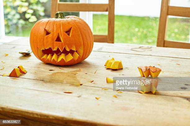 Carved Pumpkin on Farmhouse Table