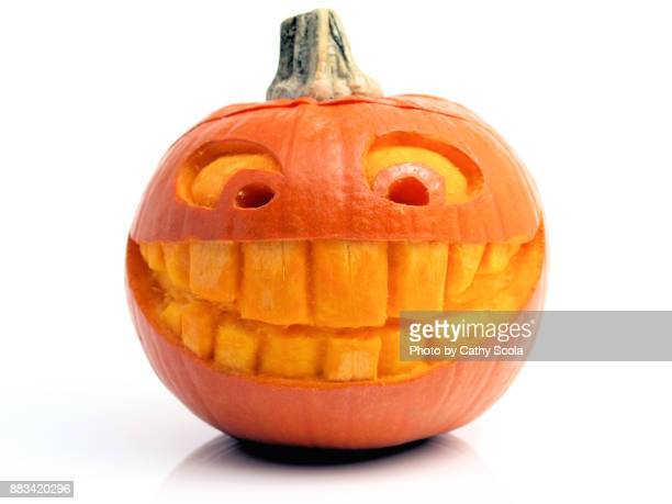 carved pumpkin - halloween lantern stock photos and pictures