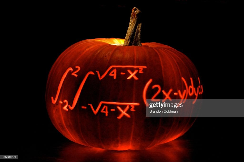 Carved pumpkin with math equation : Stock Photo
