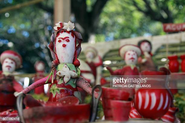 Carved radishes are displayed during the celebration of the 'Night of the Radishes' at the Ocototlan de Morelos community in Oaxaca State Mexico on...