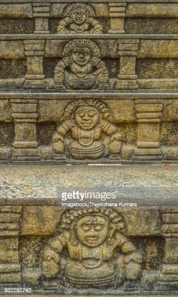 carved relief of guardian figure, moneragala temple, rambadagalla. kurunegala, sri lanka. - lanka stock pictures, royalty-free photos & images