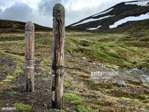 Carved road markers in saga Viking style, near Isafjordur