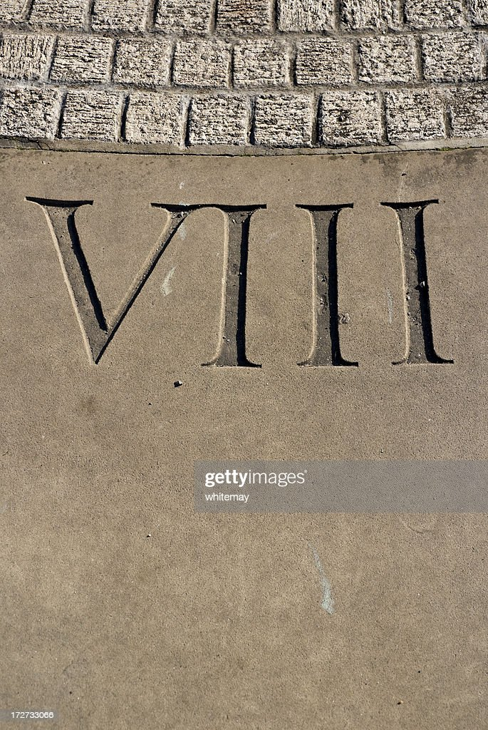 Carved Roman numeral VIII on sundial : Stock Photo