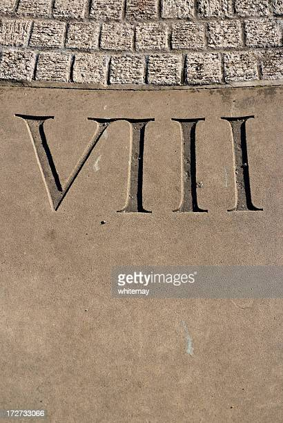 Carved Roman numeral VIII on sundial