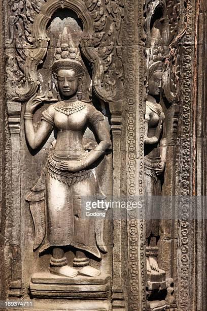 Carved sandstone basrelief Apsaras at Ta Prohm