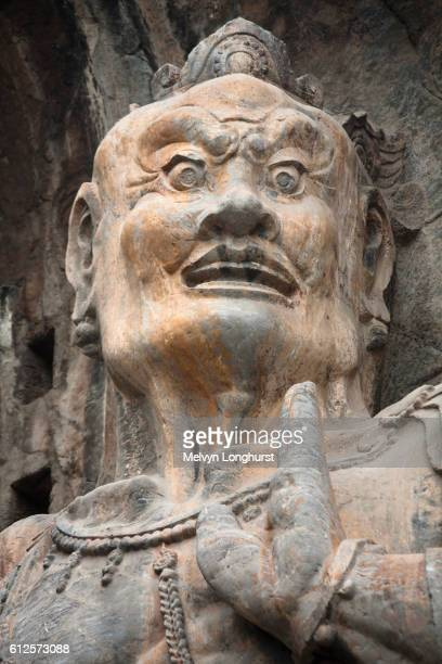 Carved statue, Fengxian Temple, Longmen Grottoes and Caves, Luoyang, Henan Province, China