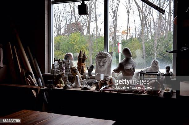Carved Statues And Tools On Window Sill