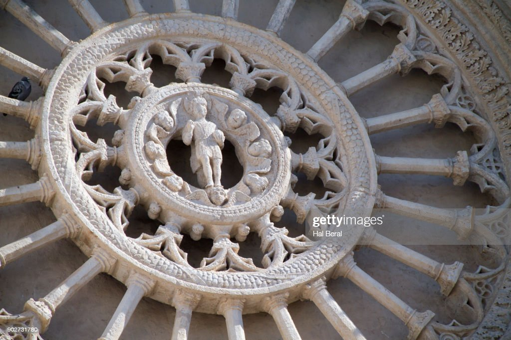 Carved stone rose window on the Ostuni Cathedral : Stock Photo