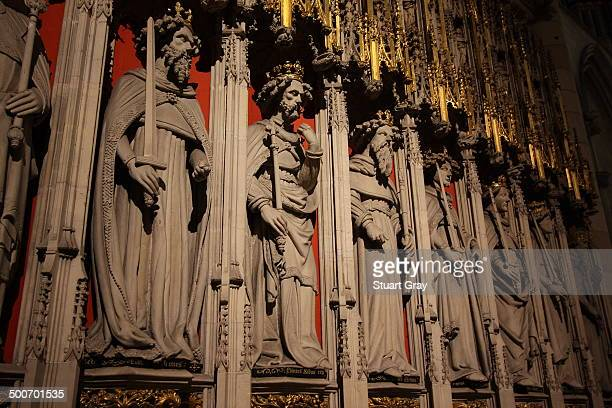 Carved stone statues of kings with gold decoration. York Minster.