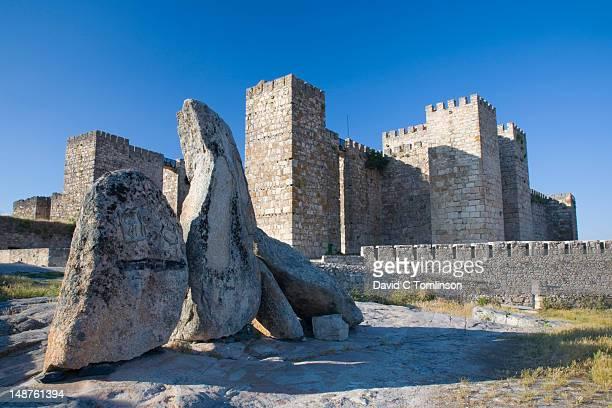 Carved stones beneath Trujillo castle.