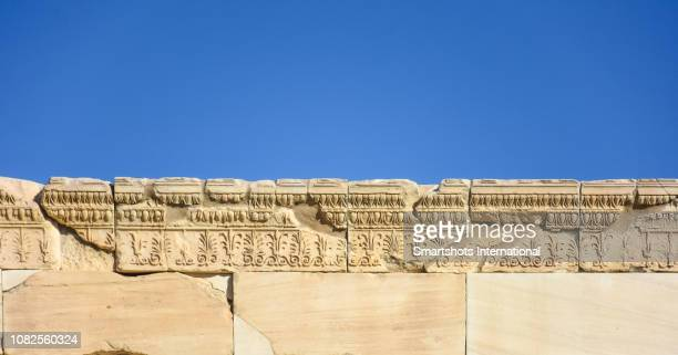 carved stones details on top of the porch of the caryatids in the erechtheion, temple of athena and poseidon, acropolis, athens, greece - parthenon athens stock pictures, royalty-free photos & images