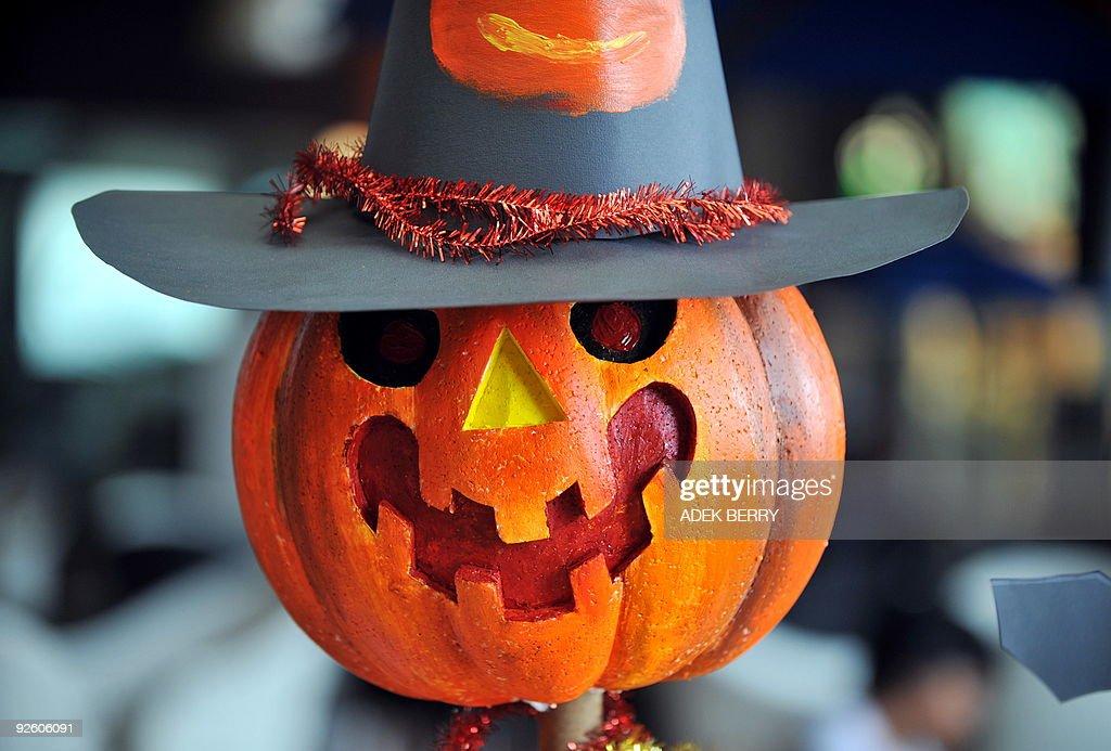 A carved up pumpkin, or jack-o-lantern i : News Photo
