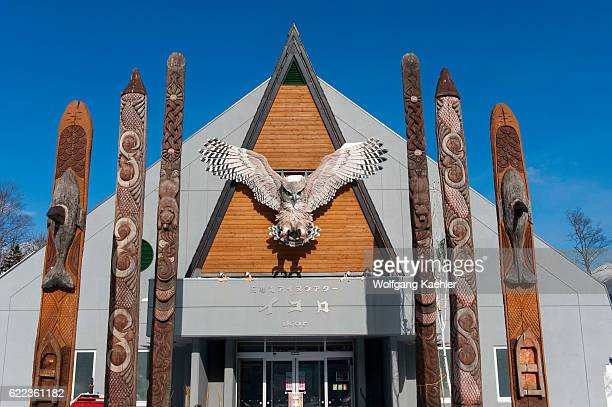 Carved wooden Ainu poles in front of the Ainu performance center in Ainu Kotan which is a small Ainu village in Akankohan in Akan National Park...