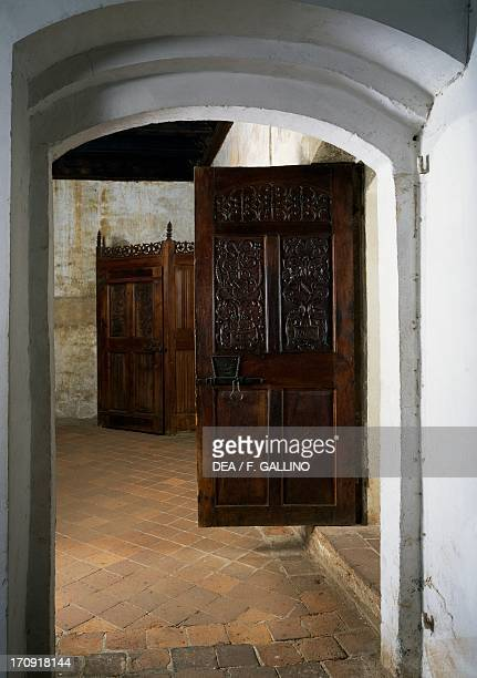 Carved wooden doors and doors with cubicle interior of Casa Cavassa Saluzzo Piedmont Italy