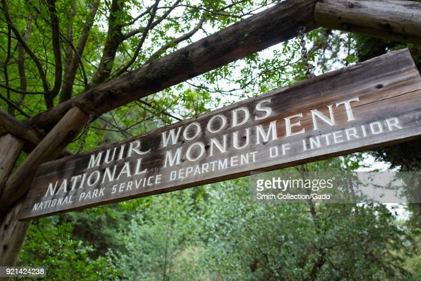 Carved wooden sign among redwood trees at the entrance to Muir Woods National Monument Mill Valley California November 20 2017