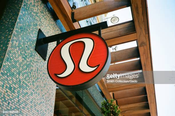 Carved wooden sign on facade of Lululemon yoga and exercise clothing retailer at Broadway Plaza in downtown Walnut Creek, California, February 27,...
