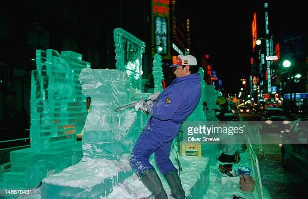 Carving a sculpture from ice for the Sapporo Yuki Matsuri (snow festival), Sapporo