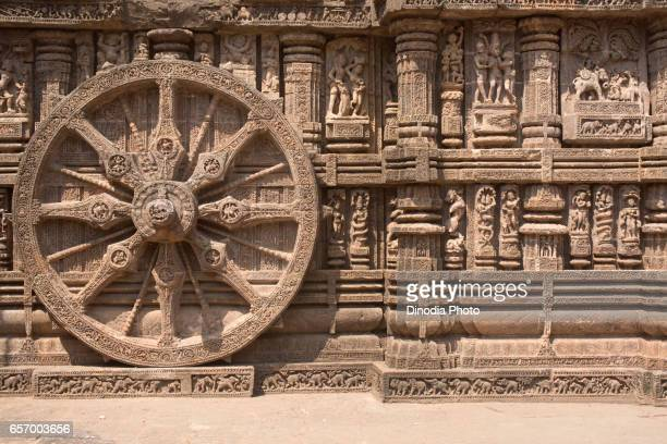 carving details of a wheel at konark sun temple, orissa, india - chariot wheel stock photos and pictures
