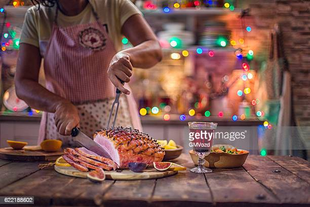 carving glazed holiday ham with cloves - thanksgiving background stock photos and pictures