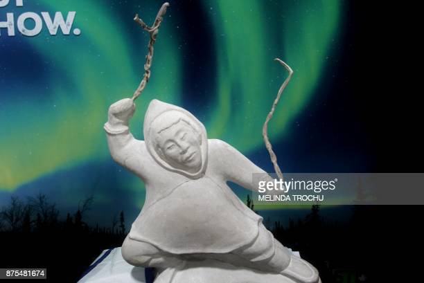 A carving made by Joe Nasogaluak and commissioned by the government of the Northwest Territories for the celebrations was unveiled on November 15...