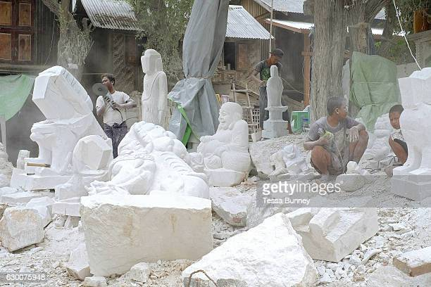 Carving marble Buddhas in Sagyin village on 19th May 2016 in Mandalay division Myanmar Sagyin a village 21 miles north of Mandalay is known for its...