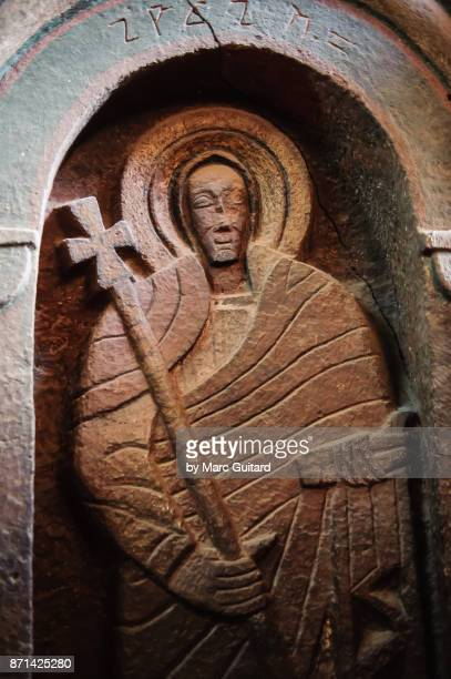 carving of a saint in a church in lalibela, ethiopia - lalibela stock photos and pictures
