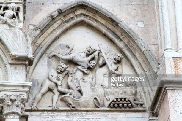 Carving of the Last Judgment on the Ferrara Cathedral exterior