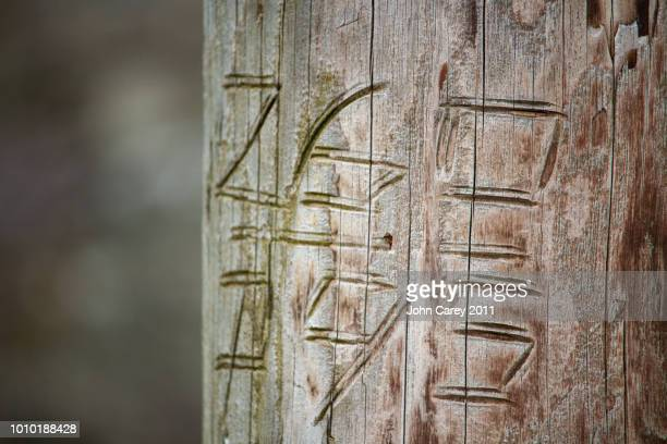 Carving on telegraph pole