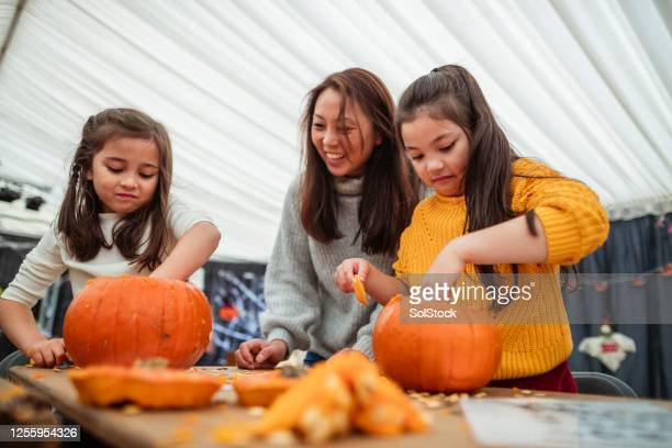 carving pumpkins with mummy - carving craft product stock pictures, royalty-free photos & images