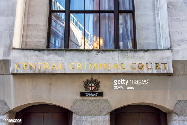 Carving with the words Central Criminal Court seen on the Old Bailey in London.