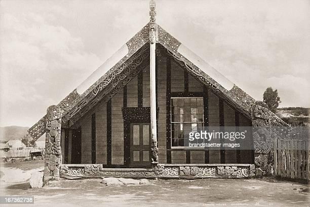 Carvings at he facade of a traditional Maori house New Zealand Photograph About 1885 Schnitzereien an einem Maori Haus Neuseeland Photographie Um 1885