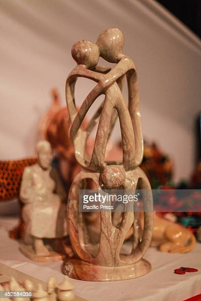 Carvings from soap stone are displayed at an artwork exhibition stall in Nairobis Kenyatta Conference Center as the curators exhibit their...