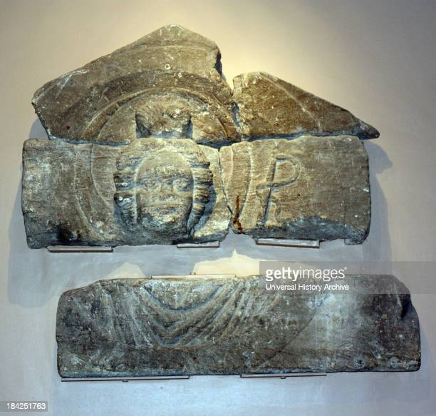 Carvings of Luna and Sol taken from pediments that were found in the temple courtyard in aquae Sulis in the Roman city of Bath England They are the...