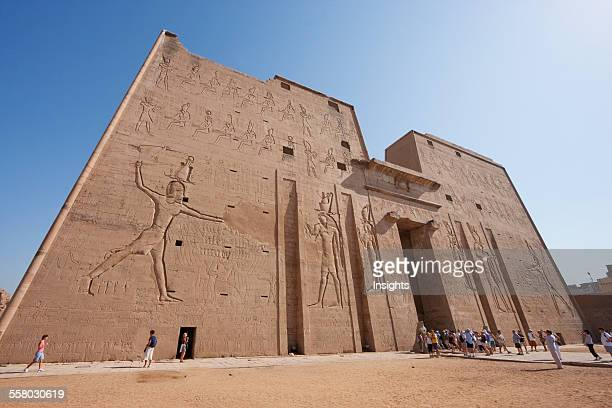 Carvings On The Massive Twin Towers Of The 36M High Entrance Pylon Of The Temple Of Horus At Edfu Aswan Egypt