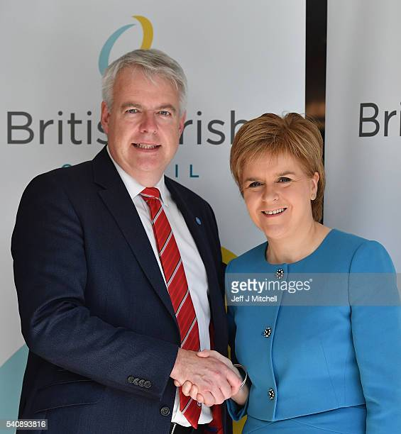 Carwyn Jones First Minister of Wales meets Nicola Sturgeon the First Minister of Scotland as they arrive for the British Irish council on June 17...