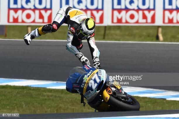 CarXpert Interwetten's Spanish rider Iker Lecuona crashes during the Moto2 race at the Australian Grand Prix at Phillip Island on October 23 2016 /...