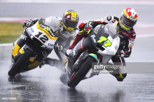Carxpert's rider Thomas Luthi from Switzerland and Kiefer Racing's rider Dominique Aegerter from Switzerland compete during the San Marino Moto2...