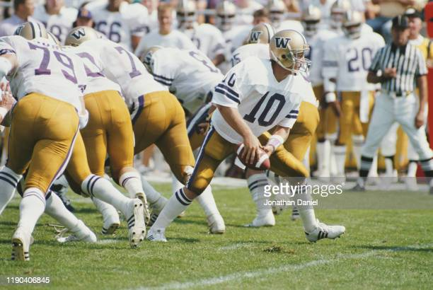 Cary Conklin, Quarterback for the University of Washington Huskies prepares to pass the ball during the NCAA Big West Conference college football...