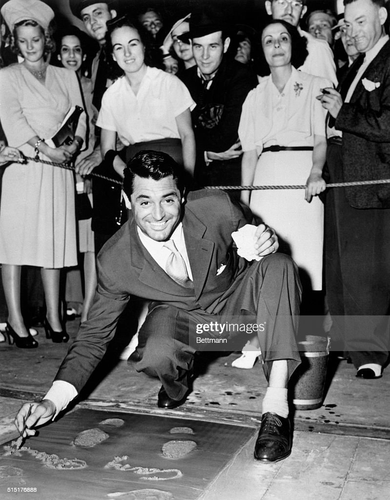 Cary Grant Signing Concrete Slab : News Photo