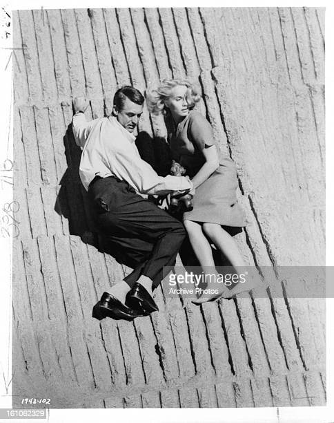 Cary Grant and Eva Marie Saint race against time in escaping in a scene from the film 'North By Northwest' 1959