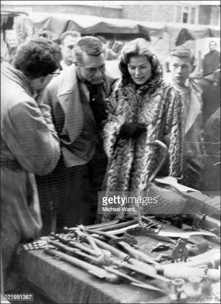 Cary Grant and Ingrid Bergman looking at a stall in Portobello Road market London 1955