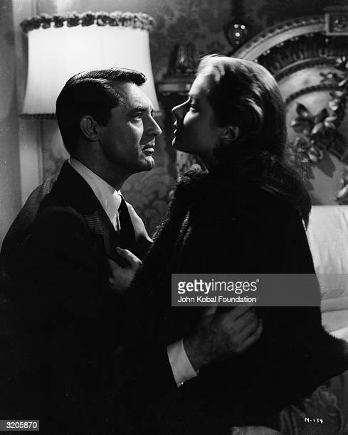 Cary Grant and Ingrid Bergman work through their emotional difficulties in Alfred Hitchcock's spy thriller 'Notorious'.