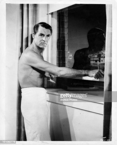 Cary Grant at window in a scene from the film 'North By Northwest' 1959
