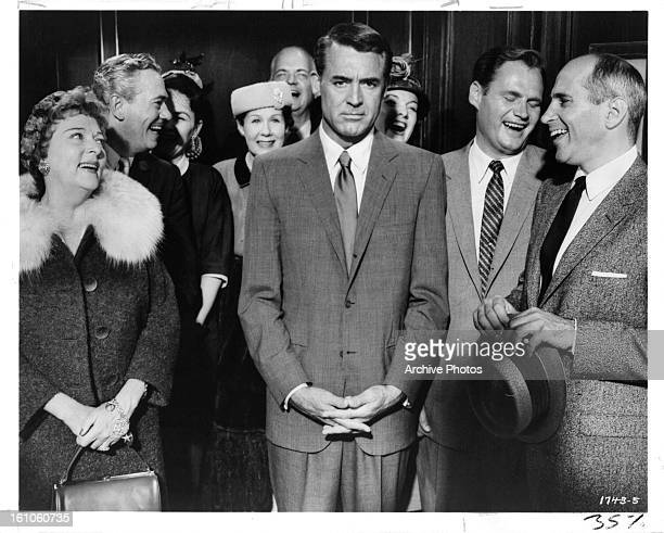 Cary Grant can't convince his mother Jessie Royce Landis that the two men to the left of him Adam Williams and Robert Ellenstein are trying to kill...