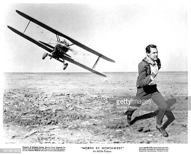 Cary Grant fleeing from plane in a scene from the film 'North By Northwest' 1959